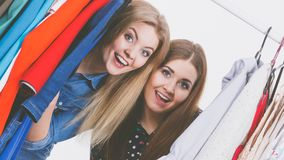Happy women clothes shopping Royalty Free Stock Images