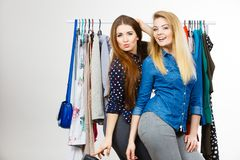Happy women clothes shopping stock image
