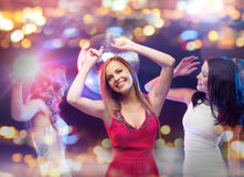 Happy women dancing at night club Royalty Free Stock Photos