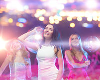 Happy women dancing at night club Stock Photography
