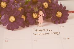 Happy women day note on calendar. Book stock image