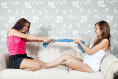 Happy women dividing clothes Royalty Free Stock Images