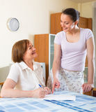 Happy women with documents at home Royalty Free Stock Image