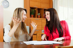 Happy women with  documents  at table i Stock Images