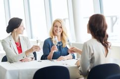 Happy women drinking champagne at restaurant Royalty Free Stock Photo