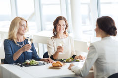 Happy women drinking champagne at restaurant Royalty Free Stock Photos