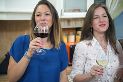 Happy women drinking wine at home. Royalty Free Stock Images