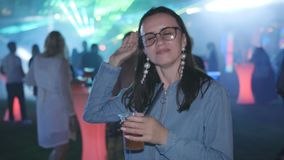 Happy women drinks during dancing at night party in lumiere lights at disco club, nightlife,. Happy women drinks during dancing at night party in lumiere lights stock video footage