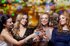 Happy women with drinks at night club Stock Image