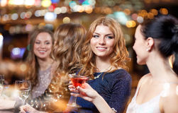 Happy women with drinks at night club Royalty Free Stock Images