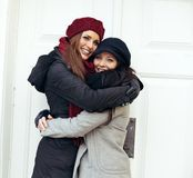 Happy Women Embracing on a Cold Winter Stock Photography