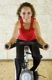 Happy women on exercise bicycle Stock Photo