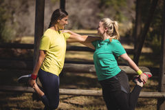 Happy women exercising during obstacle course. In boot camp stock photography