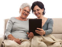 Happy women family people with tablet Royalty Free Stock Photography