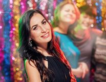 Brunette Woman partying in club. Happy women with friends having fun and partying in club Royalty Free Stock Photos