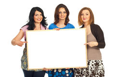 Happy women friends holding banner royalty free stock images