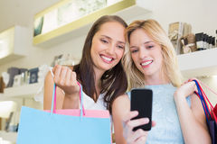 Happy women friends looking at smartphone Royalty Free Stock Photo