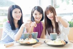 Happy woman friends in restaurant Stock Photo