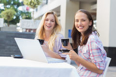 Happy women friends smiling at camera with cups of coffee Stock Image