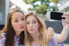 Happy women friends taking a selfie Royalty Free Stock Image