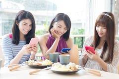 Happy woman friends in restaurant Stock Photos