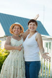 Happy women  in front of  home Royalty Free Stock Images