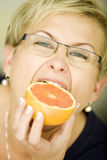 Happy women with fruits Royalty Free Stock Photos