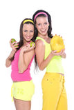 Happy women with fruits Stock Photos