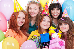 Happy women with gifts and balloons Stock Images