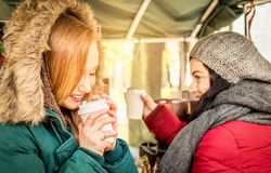 Happy women girlfriends best friends sharing time together with coffee. Happy girlfriends best friends sharing time together with coffee takeaway cup in autumn stock images