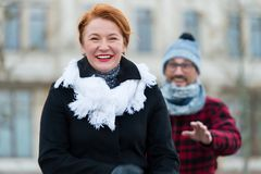 Smiling woman go away from man. Guy catching up happy woman on street. royalty free stock images