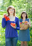 Happy  women with  harvest in orchard Royalty Free Stock Photography
