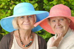 Happy women in hats. Royalty Free Stock Photography