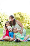 Happy women with her children Royalty Free Stock Image