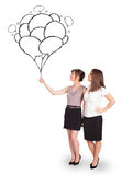 Happy women holding balloons drawing Stock Photography