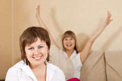 Happy  women in home Stock Images