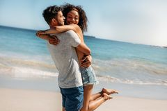 Romantic couple having fun at the beach royalty free stock images