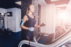 Happy women jogging on a treadmill for health. stock photo