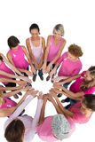 Happy women joined in a circle and looking at each otherwearing Royalty Free Stock Photo