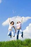 Happy women are jumping Royalty Free Stock Image