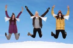 Happy women jumping in winter stock photos