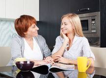 Happy women on the kitchen Stock Photos