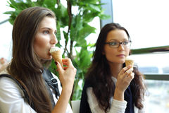 Happy women licking ice cream Stock Photo