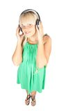 Happy women listening music in headphones Stock Photos