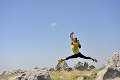 Happy women in long jump. Beautiful, happy woman in long jump. she was jumping on trampoline royalty free stock photography