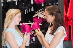 Happy women looking at a bra Stock Photography