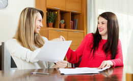 Happy women looking financial documents Stock Photo