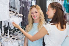 Happy women looking at lingerie Royalty Free Stock Photography