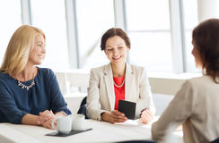 Happy women looking at restaurant bill royalty free stock image
