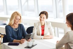 Happy women looking at restaurant bill Stock Photography